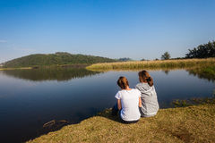 Girls Sitting Banks River Lagoon Stock Photos