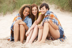 Girls Sitting On Beach Together Stock Images