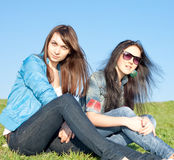 Girls sitting looking at camera Royalty Free Stock Photo