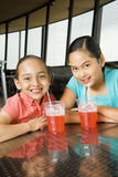 Girls Sitting and Smiling with Drinks Stock Photo