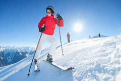 Girl smiling at ski at sunny day - winter fun Stock Images