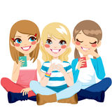 Girls Sitting Using Smartphone Royalty Free Stock Photography