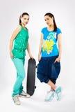 Girls with skateboard Stock Photos