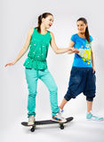 Girls with skateboard Royalty Free Stock Image