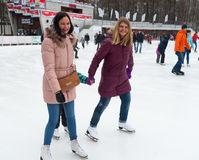 Girls skating and smiling at park Stock Photography