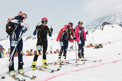Girls ski mountaineers at the starting line. Team Race ski mountaineering. Russian, Kamchatka. AVACHA AND KORYAK VOLCANOES, KAMCHATKA, RUSSIA - APRIL 27, 2014 Royalty Free Stock Photography