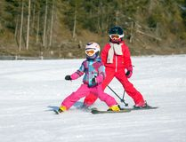 Girls on the ski Royalty Free Stock Photo