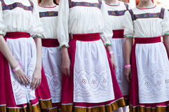 Girls in Slavonic national costumes. Girls in Slavonic national costumes  preparing for a dance performance Royalty Free Stock Photo