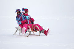 Girls on the sled Royalty Free Stock Photography