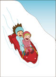 Girls sledding and laughing. Two girls sledding down a steep slope and laughing Stock Photos