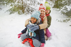 Girls on sledge Stock Image