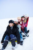 Girls sledging Royalty Free Stock Photos