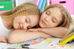 Girls sleeping at class Stock Photo