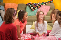 Girls at a Sleepover. Group of little young girls chat at a sleepover Royalty Free Stock Photography