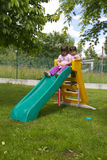 Girls on slide Stock Photo