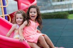 Girls on the slide Stock Photo