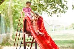 Girls on the slide Stock Image
