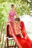 Girls on the slide Royalty Free Stock Photos