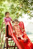 Girls on the slide Royalty Free Stock Images