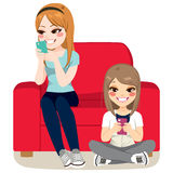 Girls Smartphone Addiction. Girls with Smartphone addiction concept sitting together Stock Image