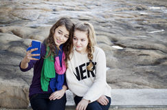 Girls with smartphone taking a photo selfie of themselves Stock Photo
