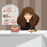 Girls smile in bakery store front of cakes dessert food Royalty Free Stock Photos