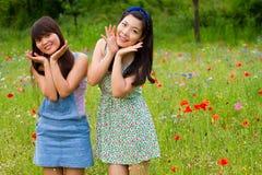 Girls smile in poppy flower field stock photography