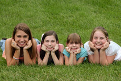 Girls Smiling. With chin in hands Royalty Free Stock Photo