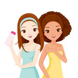Girls Smiling And Holding Beauty Packaging Royalty Free Stock Images