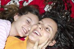 Girls smiling and hugging. Happy smiling kids sharing their secrets and bad hugging and smiling Royalty Free Stock Photos