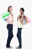 Girls smiling with a lot of shopping bags Royalty Free Stock Photo