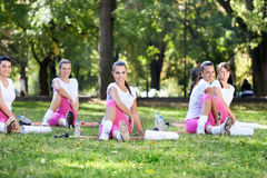 Girls smiling and stretching Stock Image