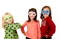Girls smiling wearing fun christmas glasses Stock Images