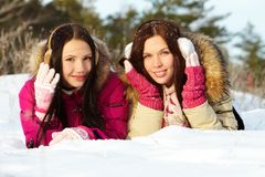 Girls on snow Royalty Free Stock Images