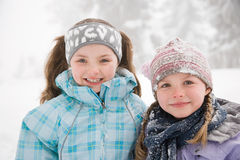 Girls in the snow Stock Images