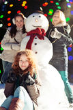 Girls and snowman Stock Photo