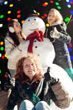 Girls and snowman Stock Photos