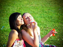 Girls with soap bubbles. Outdoor Stock Photography