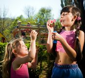 Girls with soap bubbles Royalty Free Stock Photo