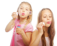 Girls with soap bubbles Royalty Free Stock Image