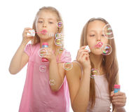 Girls with soap bubbles Stock Image