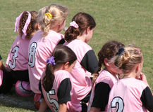 Girls Soccer. Girls at a soccer game in pink uniforms royalty free stock photo