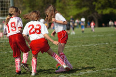 Girls on Soccer Field 34. Girls playing soccer fighting over ball Royalty Free Stock Photography