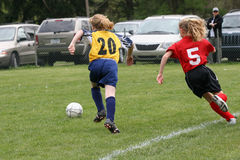 Girls on Soccer Field 42. Girls playing soccer fighting over ball Stock Photo