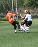 Girls Soccer Game #1. Girl soccer players in park defending potential goal royalty free stock photos