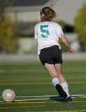 Girls soccer player with the ball Royalty Free Stock Photo