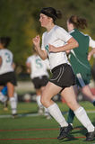 Girls soccer player on the move Royalty Free Stock Photos