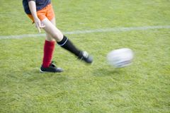 Girls Soccer Player Passing the Ball Stock Image