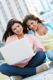 Girls social networking on a laptop Royalty Free Stock Photography