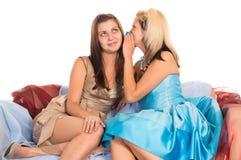 Girls at sofa Royalty Free Stock Image